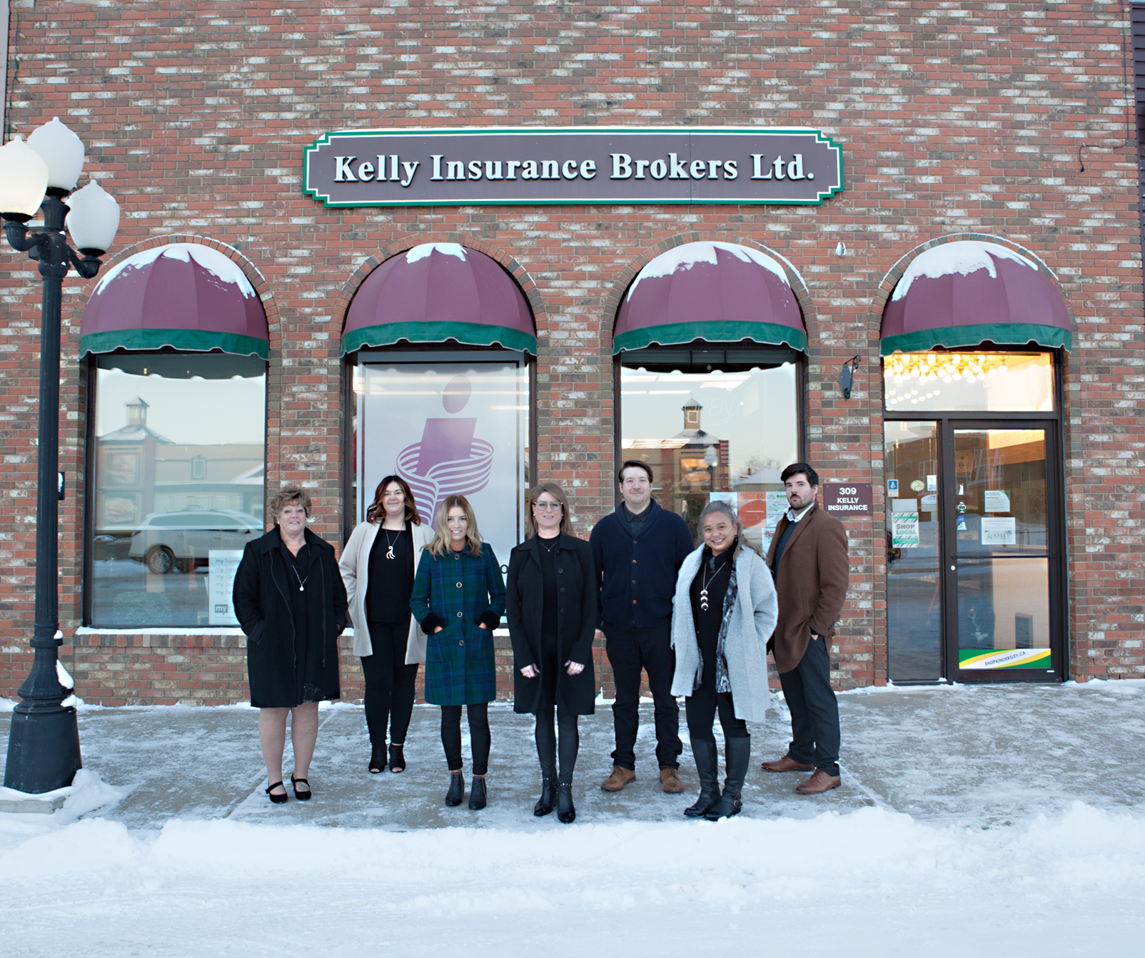 Snap front of the office with team members